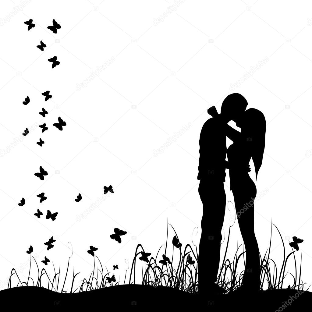 Couple kisses on a meadow