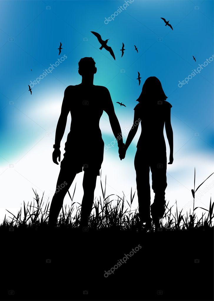 Couple walking on summer meadow