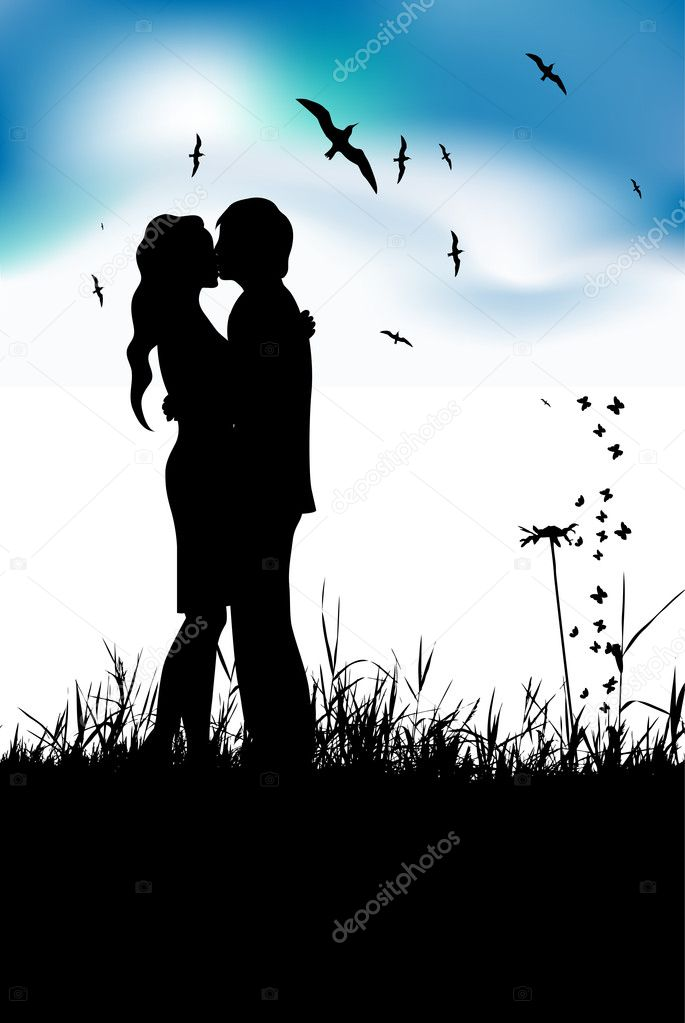 Couple kissing on summer meadow