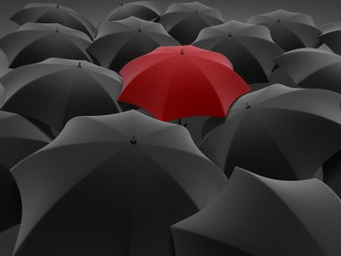 One red umbrella among set of other black