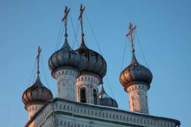 Old orthodox church cupolas at sunset, Vologda, Russia