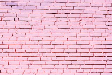 Pink brick wall texture on street