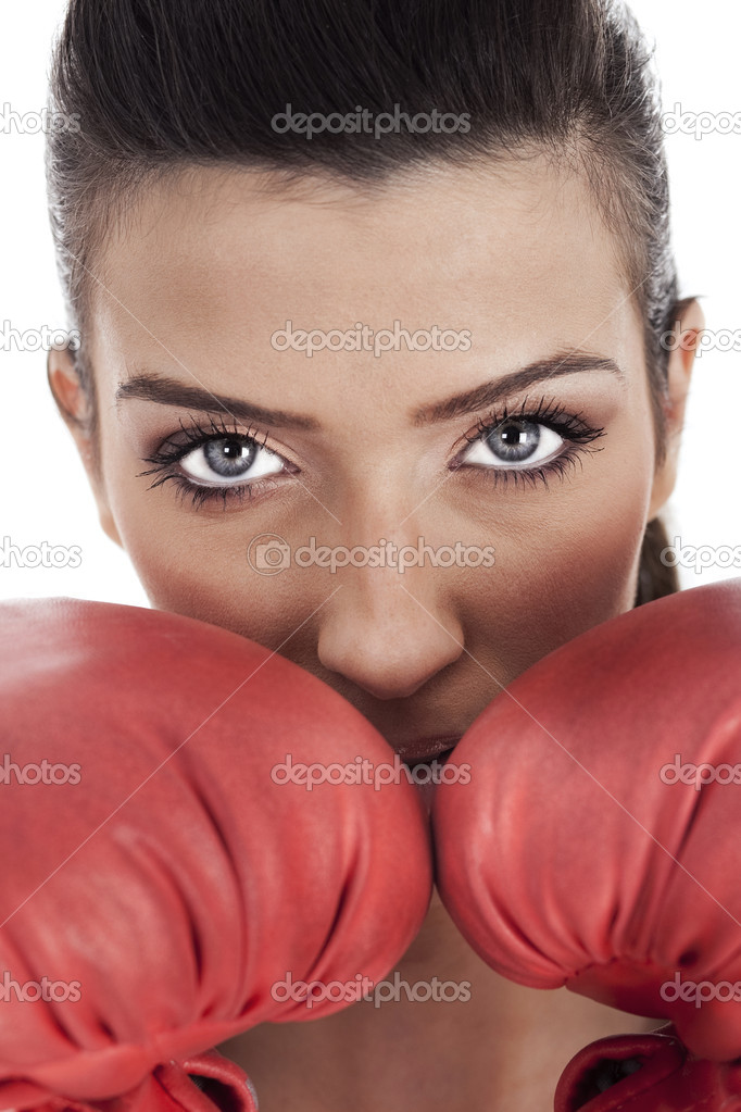 Young attractive woman wearing gloves