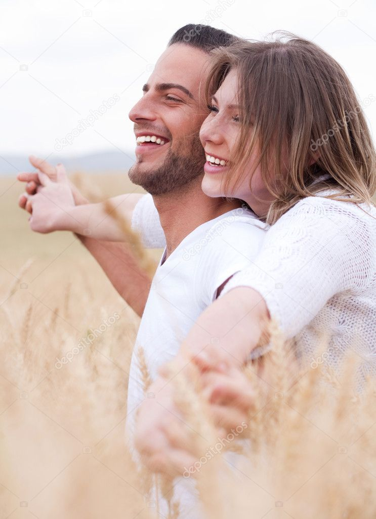 Happy young couple smiling