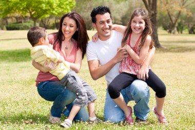 Happy family enjoying in the park