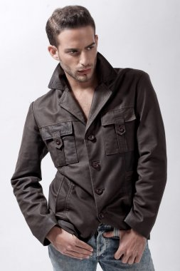 Young male model with brown jacket