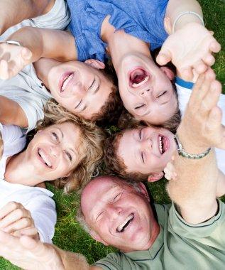 Multi-generation family lying in circle