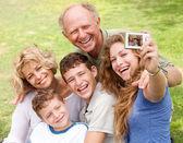 Fotografie Family outdoors taking self portrait