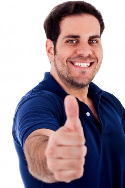 Young man gesturing thumbs up