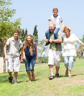 Happy family running towards camera