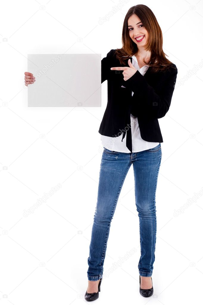 Full-length of young lady displaying blank board against an isolated background