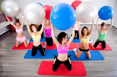 Group of doing pilates in a gym