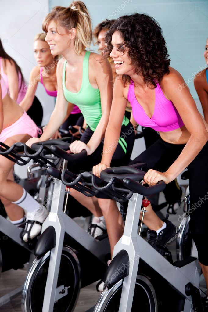 Spinning on bicycles in a gym