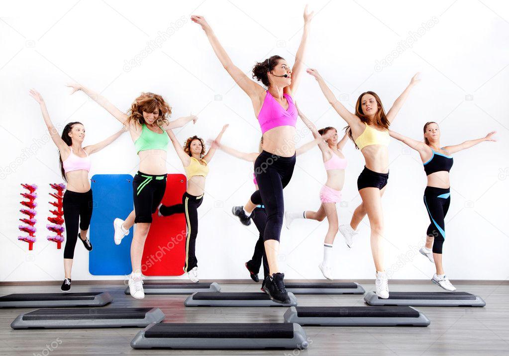 Group of women doing aerobics on stepper