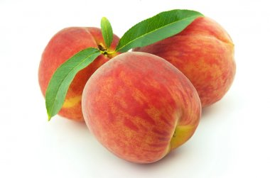 Three ripe peaches