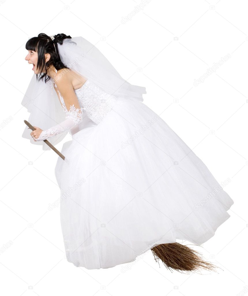 Bride In White Wedding Dress On A Broom Stock Photo