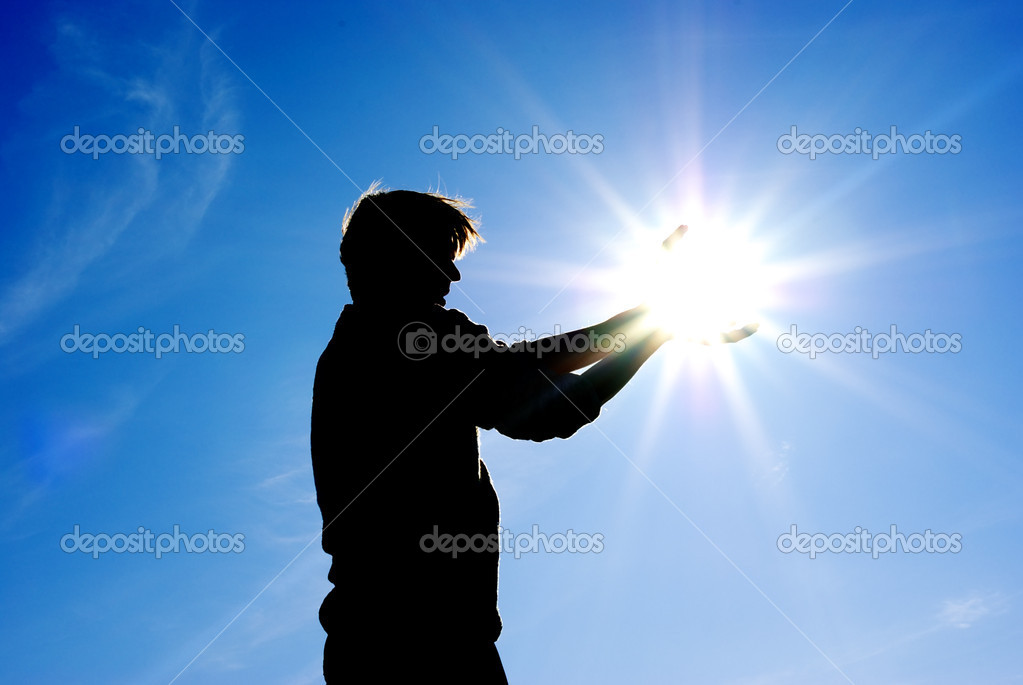 Man take sun in hands