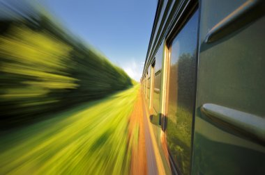 Fast riding a train with motion blur