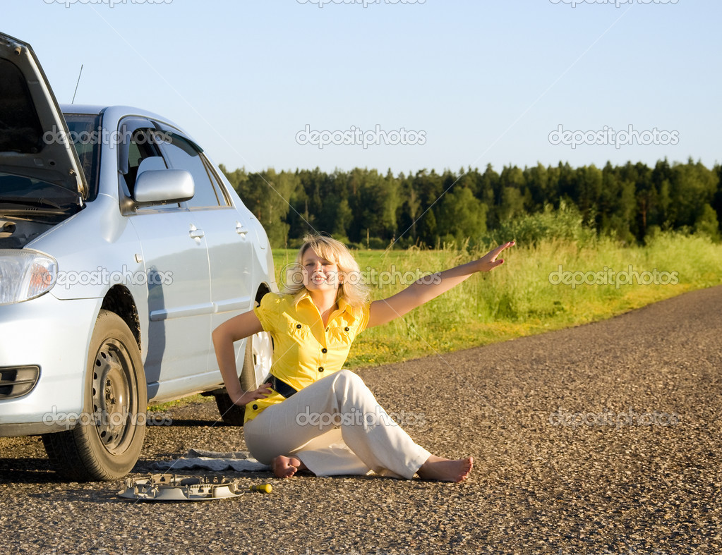 Girl sitting and signaling problems with the car