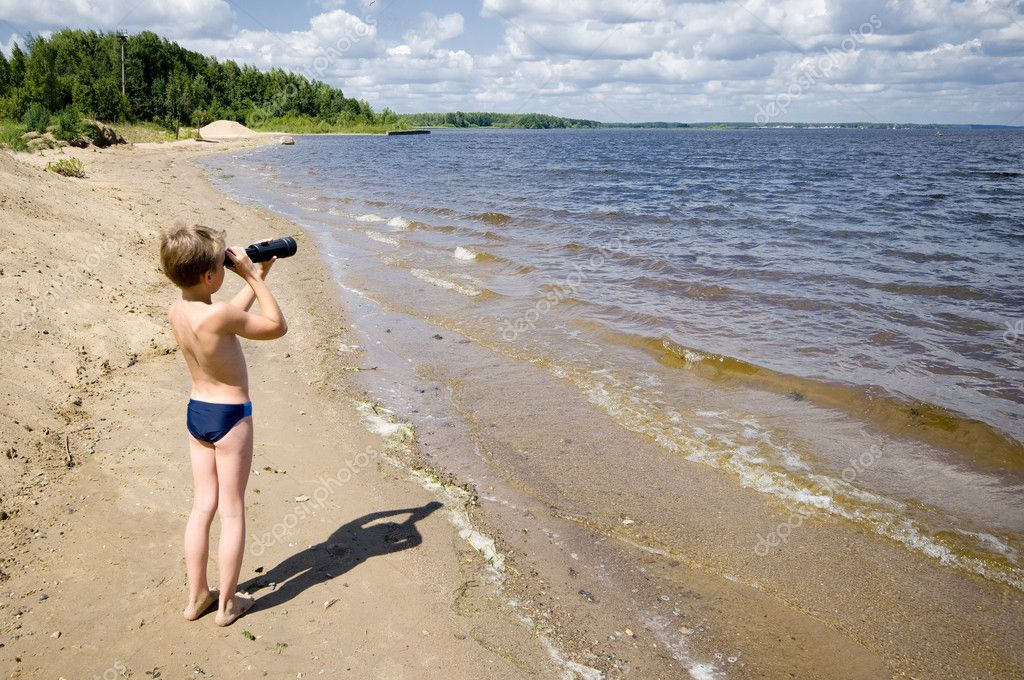 Young man looks in the binocular