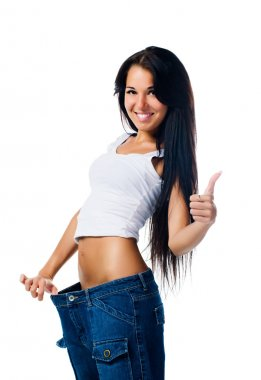 Happy woman demonstrating weight loss