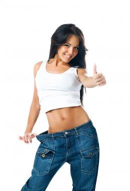 Pretty girl demonstrating weight loss
