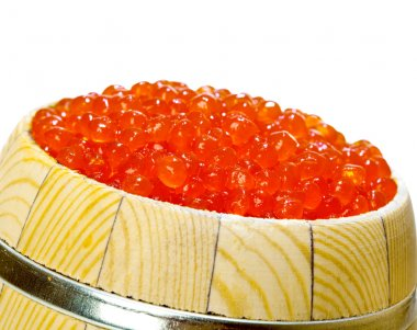 Keg of red caviar on the white