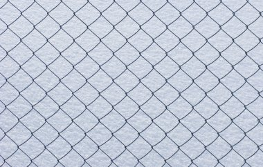 Wire netting on snow background