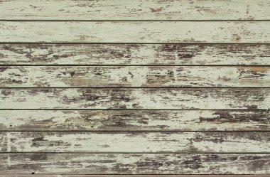 Peeled green painted wooden wall