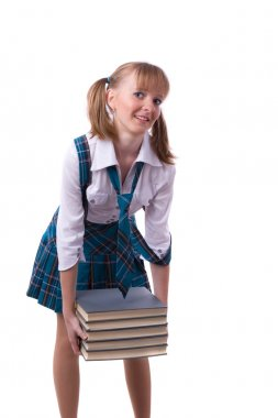 Schoolgirl is holding the stack of book.