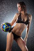 Photo Young sexy woman football player