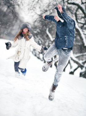 Young couple playing outdoors