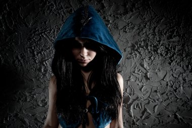 Young woman with hood on head