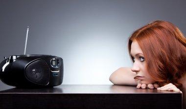 Young woman listening radio. Boring mood. stock vector