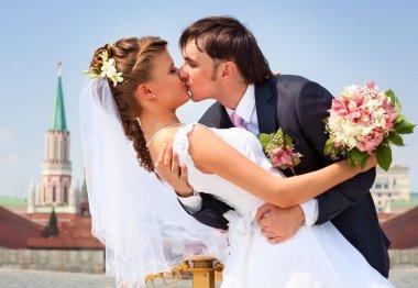 Young wedding couple kissing