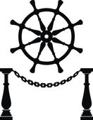 Helm. Steering wheel and anchor chain