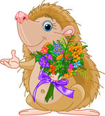 Fotografie Cute little Hedgehog giving a bouquet