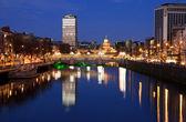 Fotografie Sunset over Dublin city
