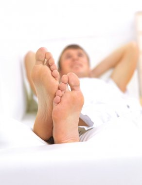 Macro of man's feet, man resting