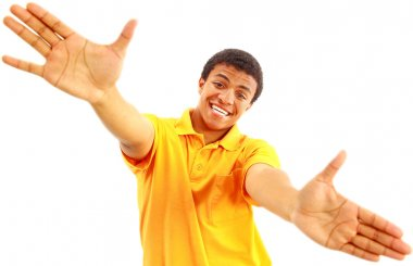 Success sign - A young man showing thumbs up sign over white background