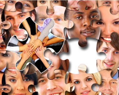 Group of business in pieces of a puzzle