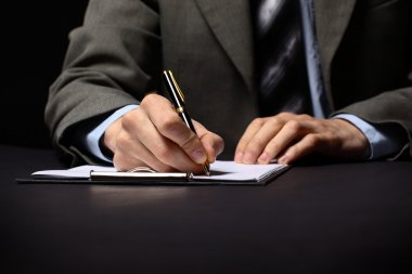 Businessman's hand with pen