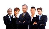 obchodní tým a vůdce - starší obchodník se svými kolegy v