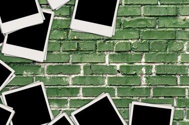 Blank Photos on Brick Background