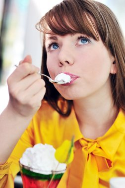 Girl eating a dessert