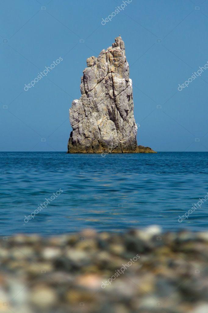 Beach, water, rock in sea