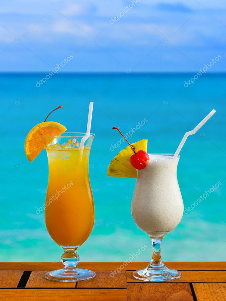 Two cocktails on table at beach cafe