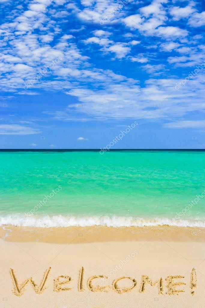 Word Welcome on beach