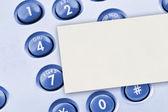 Telefonní klávesnici a papíru karta
