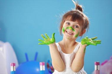 Happy Child painting in the kindergarten stock vector